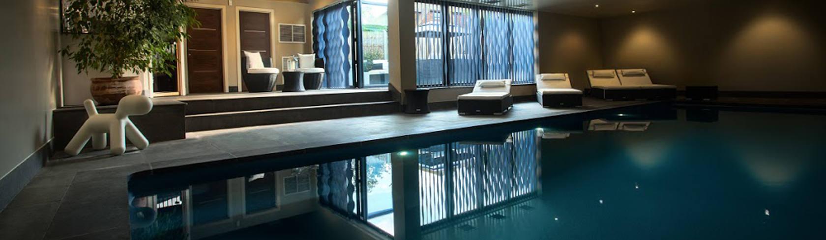 Luxury indoor swimming pool design installation compass pools for Indoor swimming pool building regulations