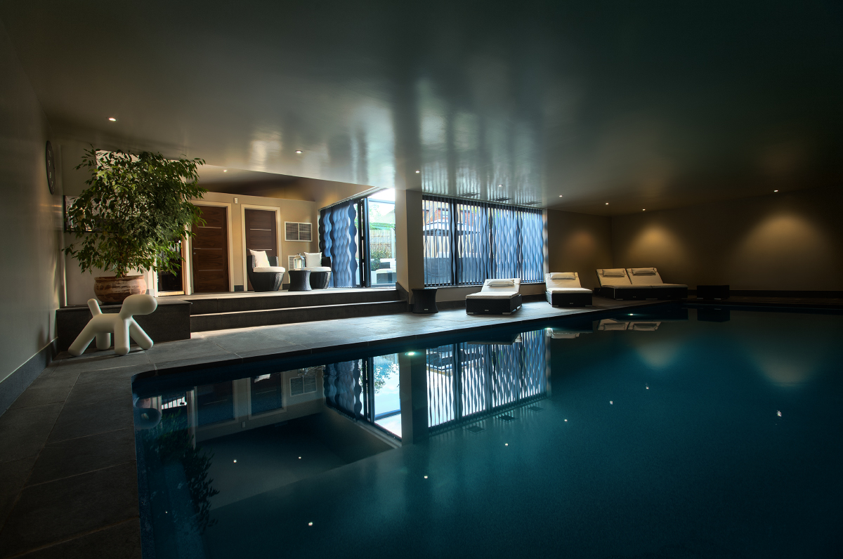 Luxury indoor swimming pool design installation for Building an indoor swimming pool