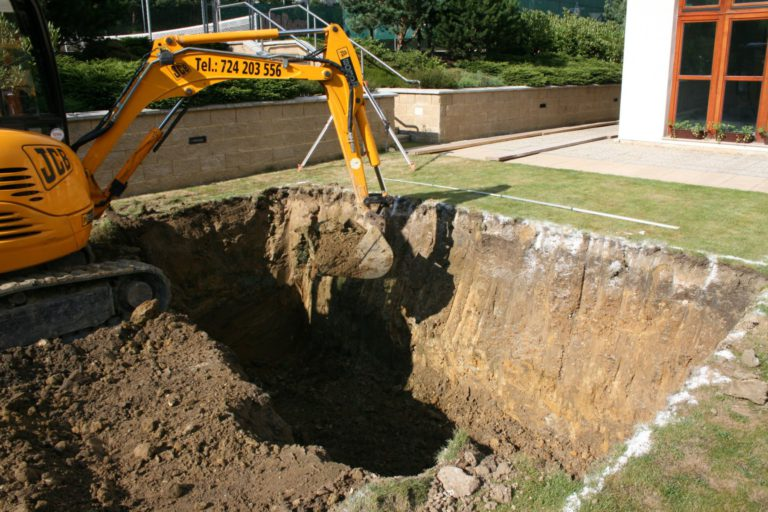 Ceramic pool installation – earth works with an excavator