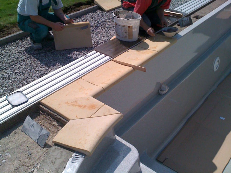 Laying the tiles around the JAVA pool