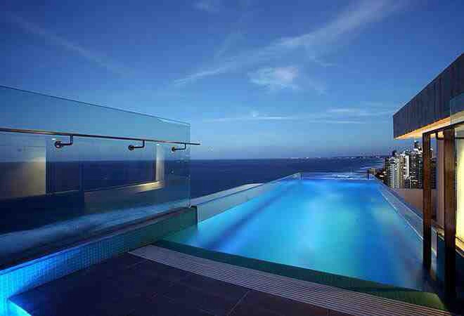 A guide to roof top swimming pool design and construction for Top pool builders
