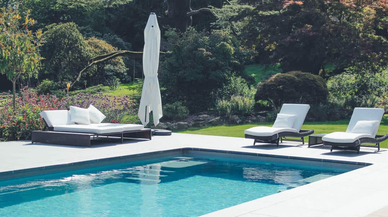 Loungers and Parasol by Pool