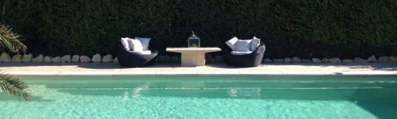 Two Garden Chairs Overlooking Pool