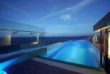 Pool Overlooking Sea at Night