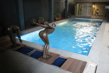Sculptures Diving Into Pool